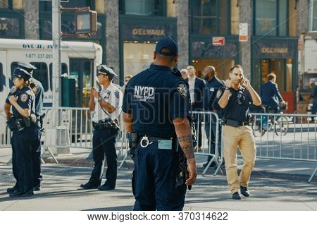 New York, Usa - 01 May, 2020: Police Officers Performing His Duties On The Streets Of Manhattan. New