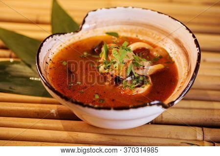 Bouillabaisse Soup Or Tom Yam On The Bamboo Background. Closeup View.
