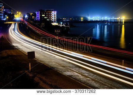 Light Trails Of Cars At Seaside Motorway In The Night Long Exposure