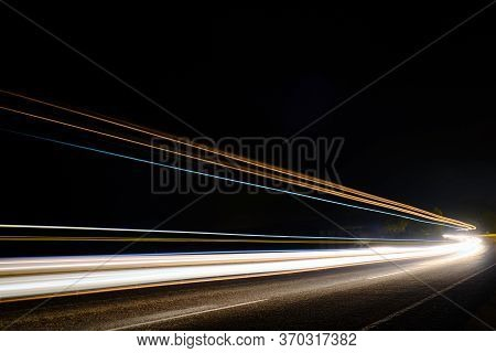 Light Trails Of Cars At Motorway In The Night Long Exposure