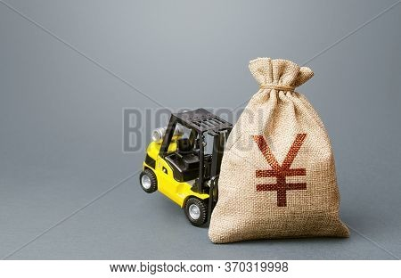 A Forklift Cannot Lift A Yen Yuan Money Bag. Strongest Financial Assistance, Support Of Business And