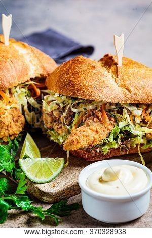 Crispy Fried Chicken Sandwich With Coleslaw Salad On The Board.