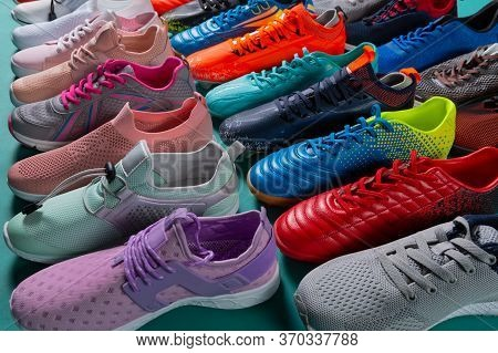 Many Colored Sports Shoes, Sneakers And Football Boots, Stand In A Row