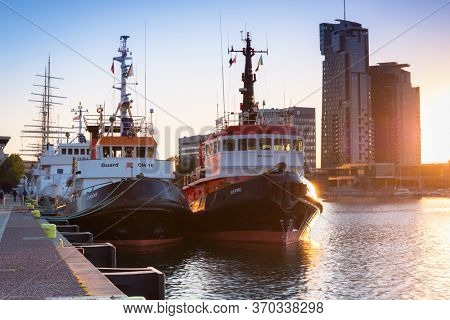 Gdynia, Poland - June 3, 2020: Pier at Baltic Sea with Sea Towers skyscraper in Gdynia, Poland. Gdynia is an important seaport of Gdansk Bay on Baltic Sea in Poland.