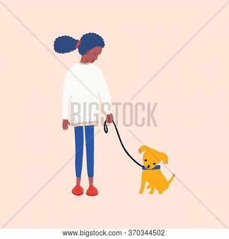 African American Girl Volunteering In Animal Shelter Walking Little Puppy.