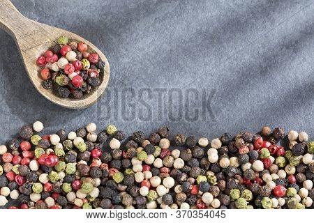 Mixture Of Hot Pepper Peppers, Red Pepper, Black Pepper, White Pepper, Green Pepper.
