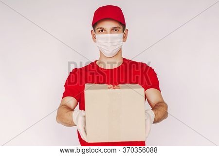 Portrait Happy Man Delivery Service Worker In Uniform, Medical Face Mask, Protective Gloves Carry Ca