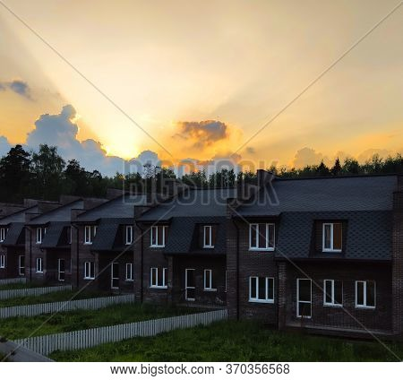 Townhouses And The Evening Sky. Moscow Region. Summer, June.