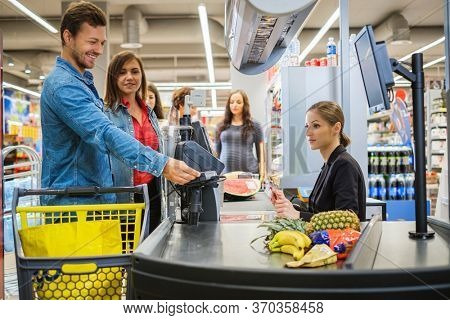 People buying goods in a grocery store