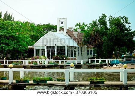 Beautiful White Cottage And Boathouse At The River