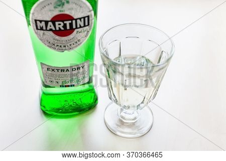 Moscow, Russia - May 23, 2020: Wineglass With Drink And Bottle Of Martini Extra Dry On Light Brown T