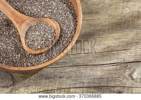 Organic Chia Seeds - Salvia Hispanica. Wood Background