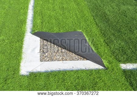 Between The Dividers Of The Football Field, Artificial Grass And The Surrounding Area Is Under Repai