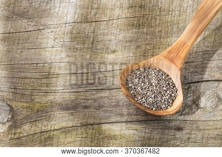 Chia Seeds In The Wooden Spoon - Salvia Hispanica