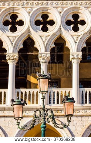 Palazzo Ducale in Piazza San Marco. Decorative street lamps. Facade decorative elements. Doge's Palace. Magical journey to Venice. The concept of educational, cultural and photo tourism