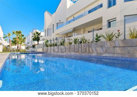 Torrevieja, Spain - June 2, 2020: Modern Residential Complex With Swimming Pool. Concept Of Rented A