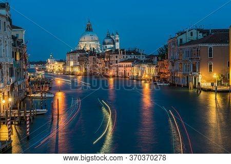 View Of Basilica Di Santa Maria Della Salute And Grand Canal From Accademia Bridge At Night In Venic