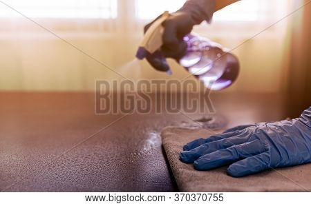 Hands Wear Blue Rubber Gloves To Prevent Germs And Use Disinfectant Sanitizing Spray Cleaning Home O