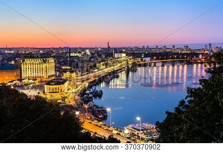Cityscape Of Kiev With The Dnieper River At Sunset. Ukraine