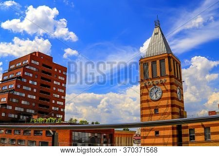 Dnepr, Ukraine, July 28. View Of Clock Tower And Modern Skyscrapers In The Big City On The Backgroun