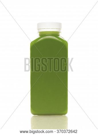 Cold-pressed Spinach Juice For Detoxification Against A White Background. Juice Made Of Organic Frui