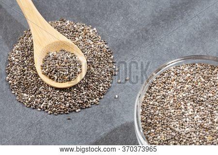 Organic Chia Seeds In The Wooden Spoon - Salvia Hispanica