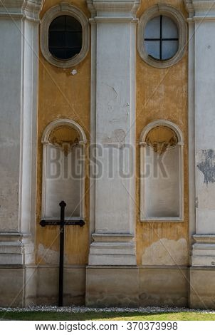 Weathered Yellow Facade With White Details Of A Baroque Church Of Saint Stephen (svaty Stefan). Wood
