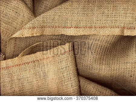 Burlap Fabric Texture Closeup. Detailed Shot Of Crumpled Natural Fabric. The Basis For A Variety Of