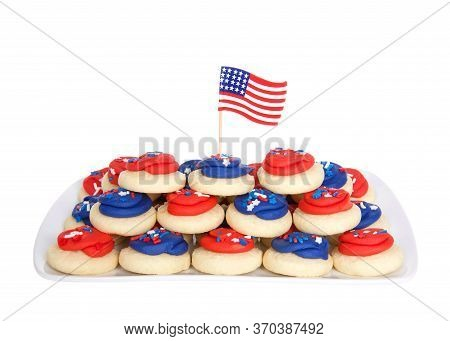 Rectangular Porcelain Plate Full Of Patriotic Sugar Cookies Frosted In Red And Blue Frosting, Covere