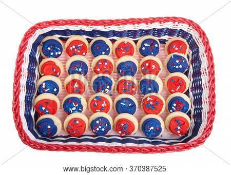 Patriotic Basket In Red, White And Blue Filled With Bite Sized Sugar Cookies Frosted In Red And Blue