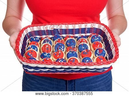 Young Female Holding Patriotic Basket, Red, White And Blue Filled With Bite Sized Sugar Cookies Fros