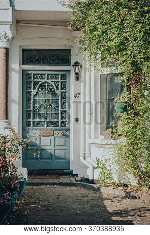 London, Uk - May 26, 2020: Pastel Stained Glass Front Door Of Edwardian House In London, Sunlight Hi