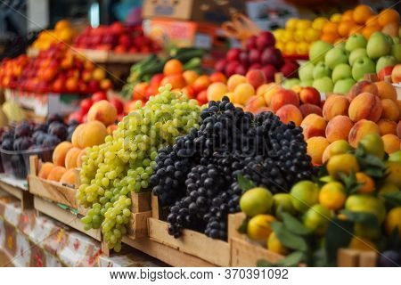 Fresh Fruits And Vegetables Are Sold At The Farmers Market. Selective And Soft Focus. Seasonal Fruit