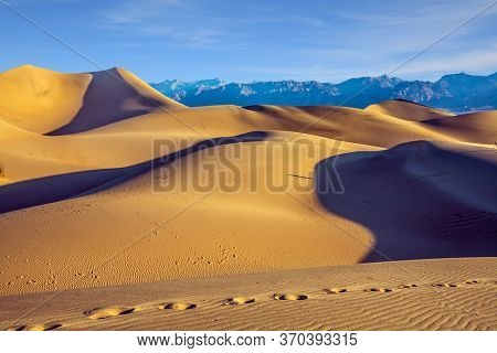Magical desert morning. Mesquite Flat Sand Dunes - dunes in Death Valley, USA. Easily accessible dunes are located along Road 190. The concept of active, extreme and photo tourism