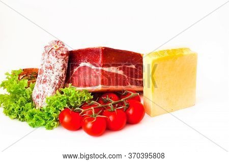 Authentic Italian Prosciutto Dry-cured On White Isolated Background. Air-dried Ham And Organic Tomat