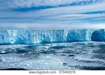 Large Blue  Iceberg In Admiralty Bay Antarctica.