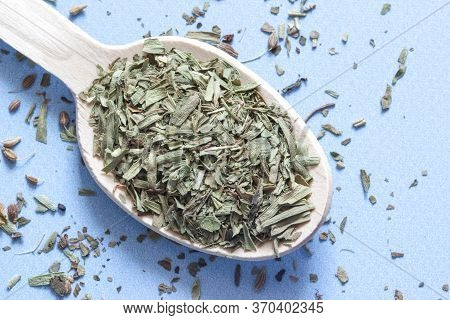 Spoon Of From Herbs. Wooden Spoon With Estragon On The Blue Background