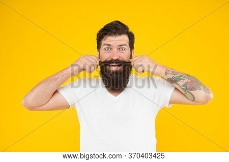 Fashion Is His Life. Cheerful Stylish Man Smiling. Happy Brutal Bearded Man On Yellow Background. Ha