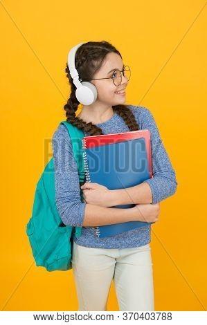 Listening Activities. Small Kid Practise Listening Skills. Happy Child Listen To Music. Listening Co