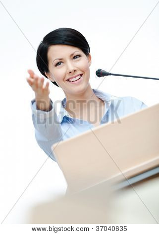 Female lecturer at the podium. Business training