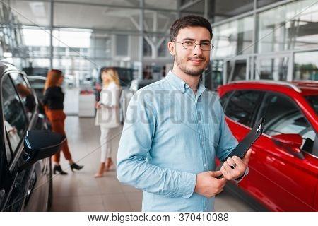 Portrait Of Salesman Car Dealership. Manager Of Car Dealership
