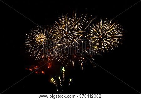 Beautiful Golden Firework Isolated On Black Background. Firework Explode In Night Sky. Template To D