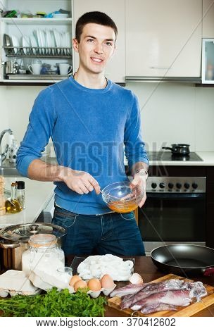 Smiling Guy Preparing Batter For Cooking Calamary Rings