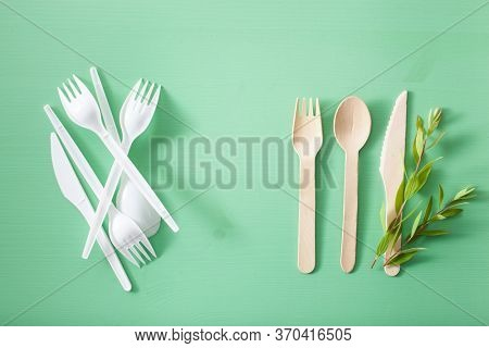 harmful plastic and eco friendly wooden cutlery. plastic free concept