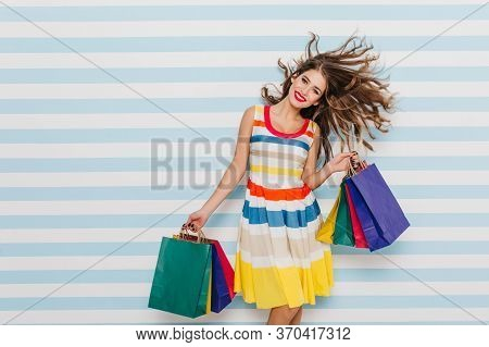 Dark-haired Female Model Dancing After Summer Shopping. Attractive Well-dressed Woman Expressing Pos
