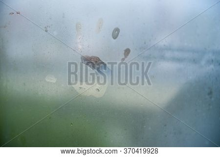 Childs Hand Print On A Steamy Window