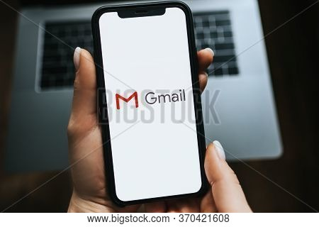 Iphone With Gmail App Logo On The Screen. Blue Background. High Quality Photo