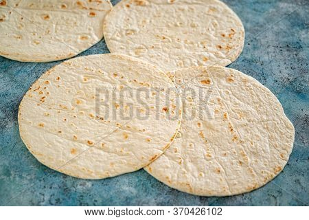 pita bread on the ble background