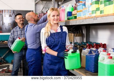 Troubleshooters And Smiling Superviser At Storage Of Auto Repair Shop