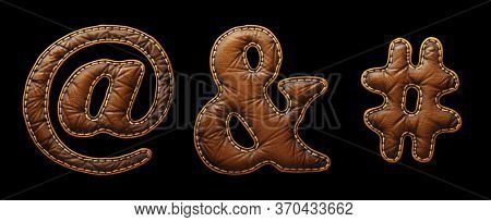 Set of symbols at, ampersand, hash made of leather. 3D render font with skin texture isolated on black background. 3d rendering